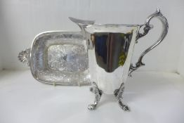 A plated water jug and a dish