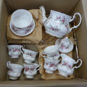 A Royal Albert Lavender tea set including a cake stand, six plates, six cups and saucers, a tea pot,