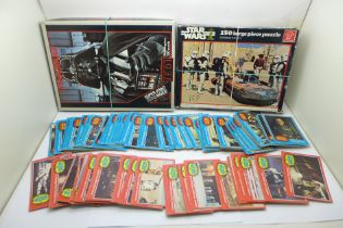 Two Star Wars themed jigsaw puzzles and various 1977 picture cards