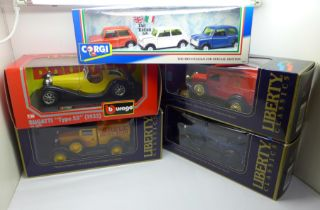 Five die-cast scale model vehicles, including Burago, Corgi, Liberty, all boxed