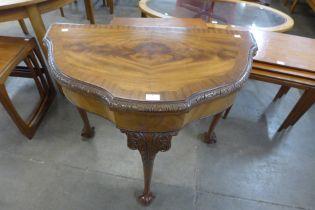 A George I style mahogany demi-lune card table