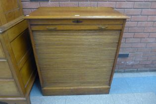 An early 20th Century oak tambour front filing cabinet