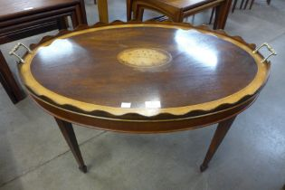 A George III style inlaid mahogany oval tray table