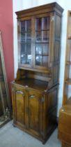 A George III style Ipswich oak bookcase