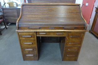 A Victorian oak tambour roll top desk