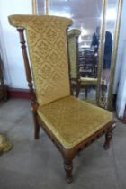 A Victorian carved walnut and fabric upholstered prie dieu