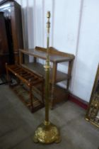 A Victorian Aesthetic Movement brass telescopic floor standing lamp