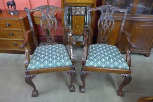 A pair of Chippendale Revival carved mahogany elbow chairs