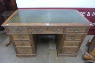 A Victorian oak pedestal desk