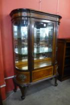 A French Louis XV style bow front mahogany display cabinet