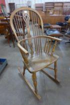 An elm Windsor rocking chair