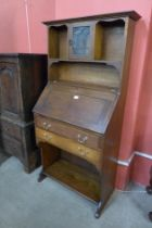 An Arts and Crafts oak bureau bookcase