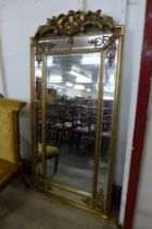 A large gilt French style gilt framed mirror with crest, 183 x 90cms (M32168) #