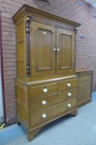 A George III oak and fruitwood housekeeper's cupboard