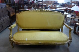A French Louis XV style gilt wood and fabric upholstered canape sofa