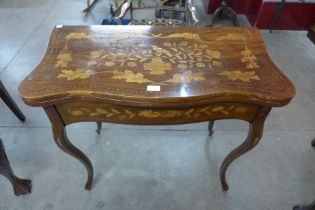 A Dutch mahogany and marquetry inlaid fold over card table