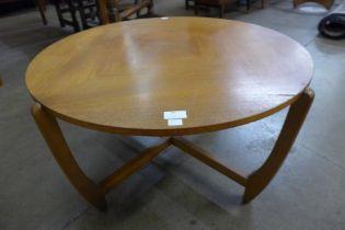A teak circular coffee table