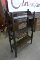 A small Arts and Crafts oak open bookcase
