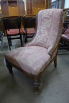 A Victorian carved oak and fabric upholstered lady's chair