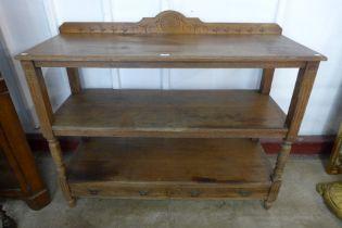 A Victorian Aesthetic Movement oak three tier buffet