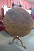 A George III mahogany circular tilt top tripod tea table
