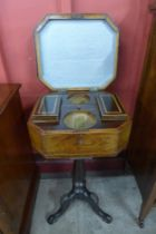 A George IV inlaid rosewood octagonal lady's sewing box, on associated mahogany tripod stand