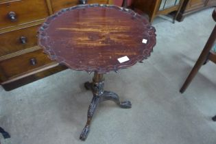 A Chippendale Revival carved mahogany birdcage action tilt top tripod table
