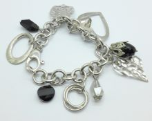 A silver charm bracelet, 55.1g