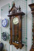 A 19th Century walnut Vienna double weight wall clock