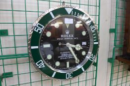 A Rolex style dealer's wall clock