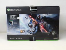 A boxed pre-owned Xbox One X 1TB in Black (Model No: 1878) with adapter and cables (no