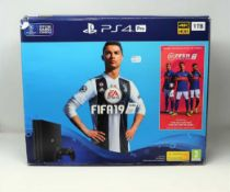 A pre-owned boxed PS4 Pro 1TB in Jet Black with charger, HDMI cable and one controller (Model: CUH-