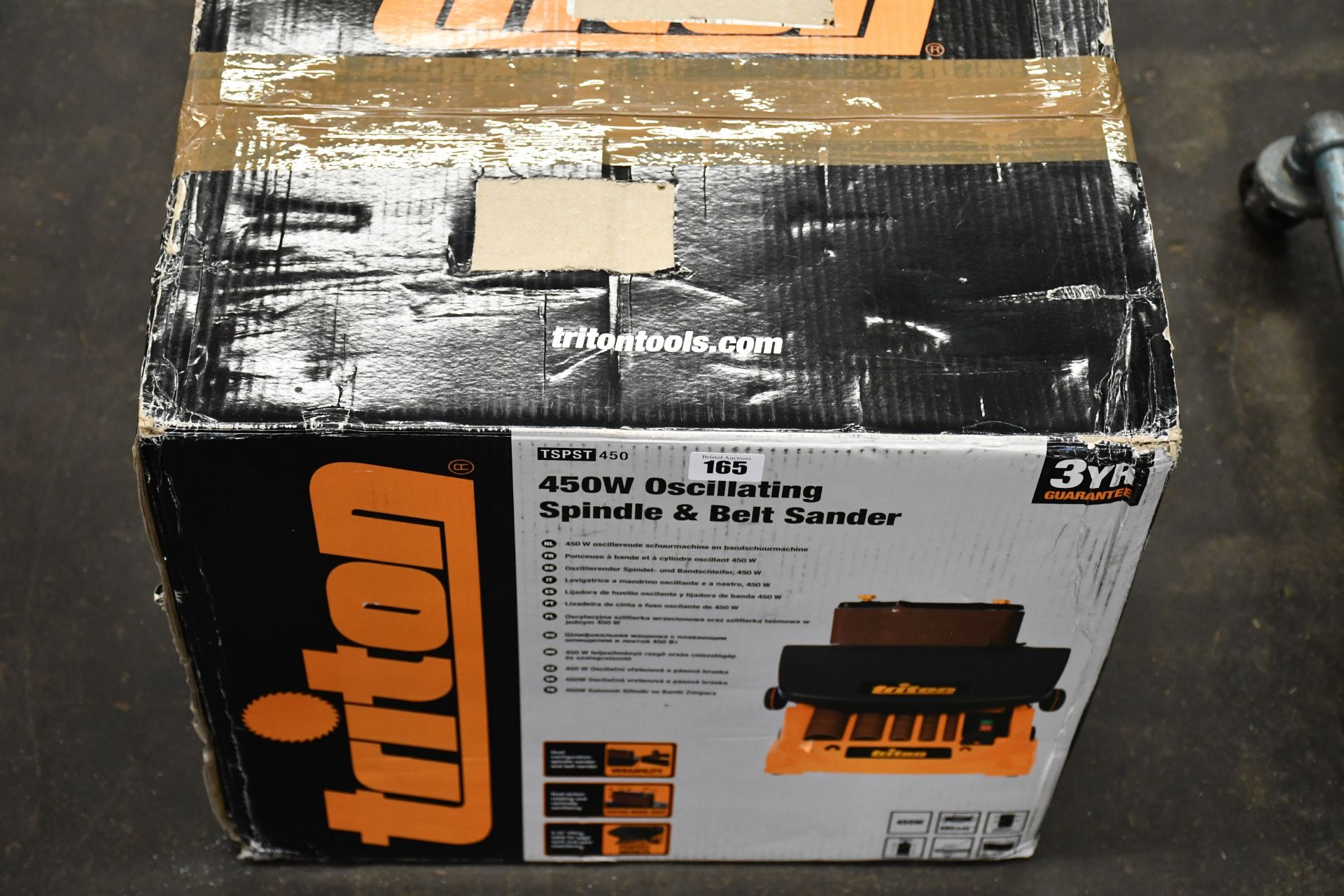 A boxed as new Triton Oscillating spindle and belt sander (450w).