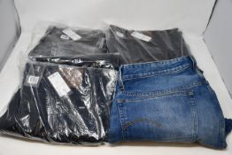 Four pairs of as new G-Star Raw jeans.