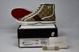 A pair of women's as new Gucci Tennis 1977 high top sneakers (EU 36 - RRP £485).