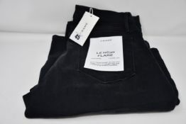 A pair of as new Frame Le High Flare jeans in condor (Size 30).