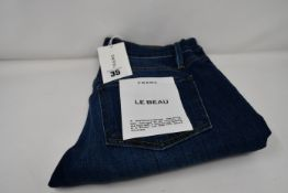 A pair of as new Frame Le Beau jeans in Burnside (Size 24).