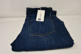 A pair of as new Frame Le Beau jeans in Burnside (Size 28).