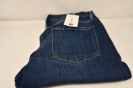 A pair of as new Frame Le Beau jeans in Burnside (Size 29).