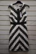An as new Karl Lagerfeld sleeveless chevron lace dress (Size US 2).