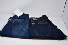 A pair of women's as new G-Star G Raw Midge zip mid skinny size 34/36 and a pair of men's as new