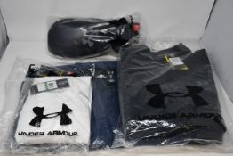 Two Under Armour X-Storm jackets (L), Cold Gear top (L) and Infrared gloves.