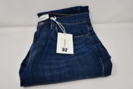 A pair of as new Frame Le Beau jeans in Burnside (Size 26).