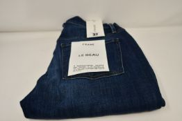A pair of as new Frame Le Beau jeans in Burnside (Size 25).