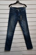 A pair of as new The Kooples Blue Destroyed jeans (28 - RRP £165).