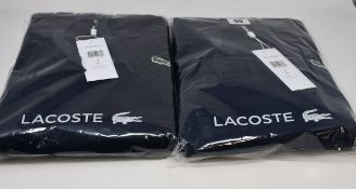 Two as new Lacoste hoodies in blue marine (US S).