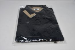 An as new Burberry Hartford polo shirt (XXL - RRP €139).