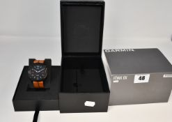 An as new Garmin Fenix X6 Sapphire watch black DLC/brown leather band.