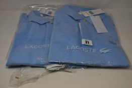 Two as new Lacoste polo shirts (US L and 3XL).