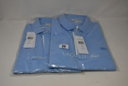 Two as new Lacoste polo shirts (US M).
